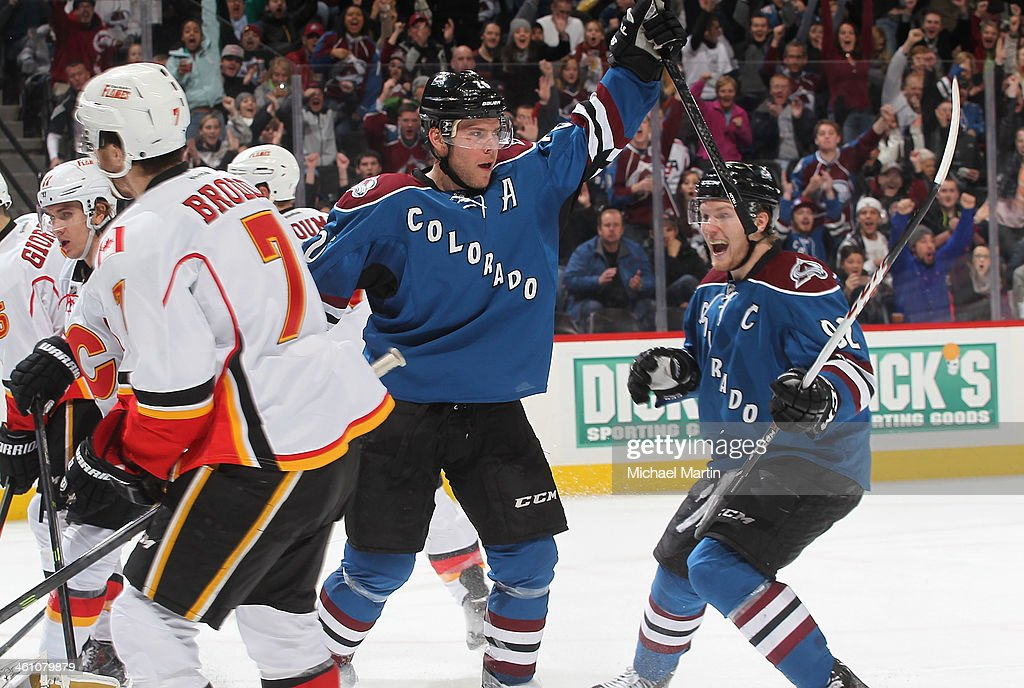 Paul Stastny #26 of the Colorado Avalanche celebrates a third period goal with teammate Gabriel Landeskog #92 against the Calgary Flames at the Pepsi Center on January 06, 2014 in Denver, Colorado. ÊThe Flames defeated the Avalanche 4-3. Ê