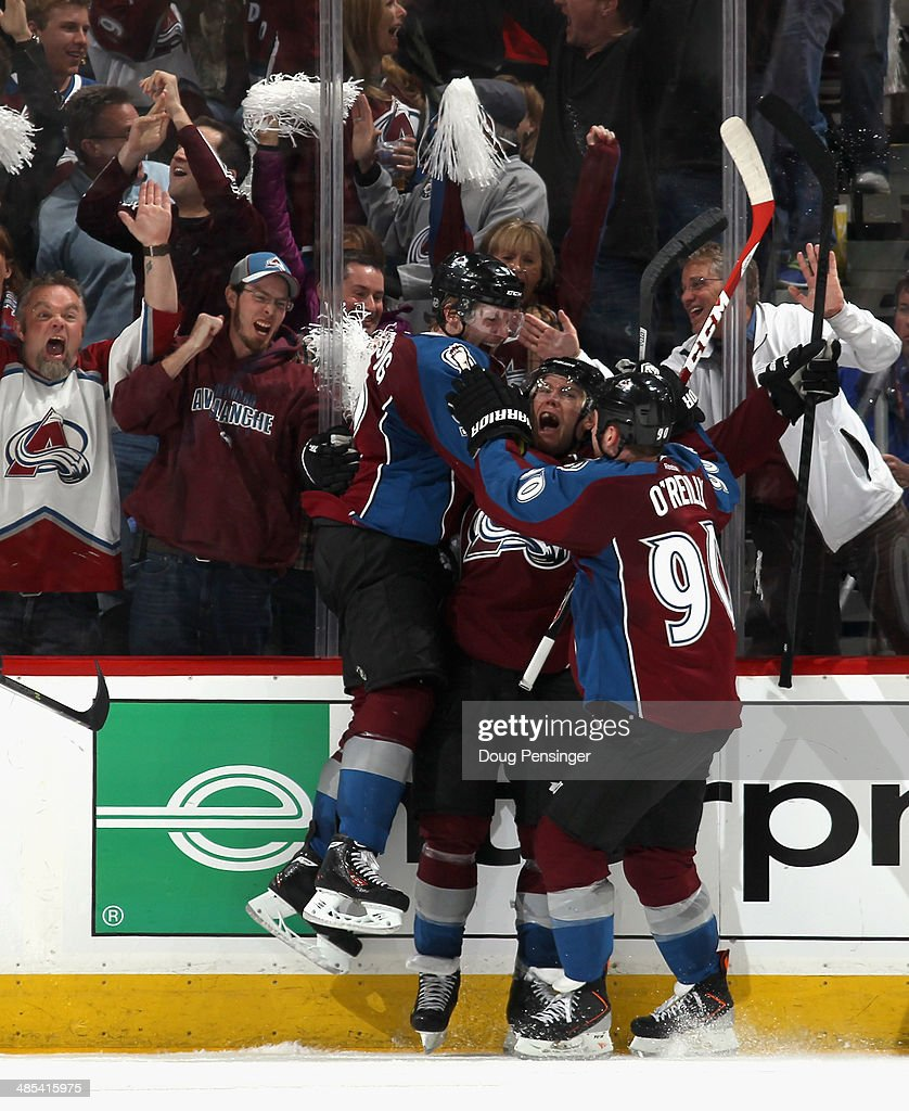 Paul Stastny #26 of the Colorado Avalanche celebrates his game tying goal with 14 seconds remaining in regulation against the Minnesota Wild with teammates Gabriel Landeskog #92 and Ryan O'Reilly #90 of the Colorado Avalanche in Game One of the First Round of the 2014 NHL Stanley Cup Playoffs at Pepsi Center on April 17, 2014 in Denver, Colorado.