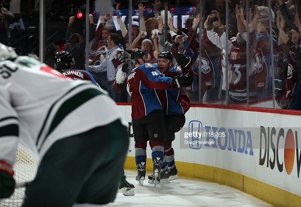 <a gi-track='captionPersonalityLinkClicked' href=/galleries/search?phrase=Paul+Stastny&family=editorial&specificpeople=2494330 ng-click='$event.stopPropagation()'>Paul Stastny</a> #26 of the Colorado Avalanche celebrates his game winning goal in overtime against the Minnesota Wild with <a gi-track='captionPersonalityLinkClicked' href=/galleries/search?phrase=Tyson+Barrie&family=editorial&specificpeople=4669265 ng-click='$event.stopPropagation()'>Tyson Barrie</a> #4 of the Colorado Avalanche in Game One of the First Round of the 2014 NHL Stanley Cup Playoffs at Pepsi Center on April 17, 2014 in Denver, Colorado. The Avalanche defeated the Wild 5-4 in overtime to take a 1-0 game advantage in the series.