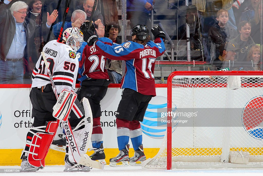 <a gi-track='captionPersonalityLinkClicked' href=/galleries/search?phrase=Paul+Stastny&family=editorial&specificpeople=2494330 ng-click='$event.stopPropagation()'>Paul Stastny</a> #26 of the Colorado Avalanche celebrates his goal against goalie <a gi-track='captionPersonalityLinkClicked' href=/galleries/search?phrase=Corey+Crawford&family=editorial&specificpeople=818935 ng-click='$event.stopPropagation()'>Corey Crawford</a> #50 of the Chicago Blackhawks along with teammate <a gi-track='captionPersonalityLinkClicked' href=/galleries/search?phrase=P.A.+Parenteau&family=editorial&specificpeople=5537244 ng-click='$event.stopPropagation()'>P.A. Parenteau</a> #15 of the Colorado Avalanche on March 8, 2013 in Denver, Colorado. The Avalanche defeated the Blackhawks 6-2 to end the Chicago's 30 game undefeated streak.