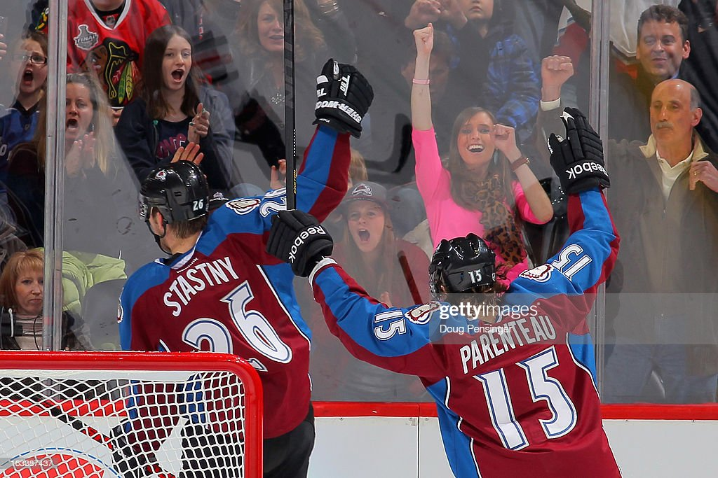 <a gi-track='captionPersonalityLinkClicked' href=/galleries/search?phrase=Paul+Stastny&family=editorial&specificpeople=2494330 ng-click='$event.stopPropagation()'>Paul Stastny</a> #26 of the Colorado Avalanche celebrates his goal against the Chicago Blackhawks along with teammate <a gi-track='captionPersonalityLinkClicked' href=/galleries/search?phrase=P.A.+Parenteau&family=editorial&specificpeople=5537244 ng-click='$event.stopPropagation()'>P.A. Parenteau</a> #15 of the Colorado Avalanche and the Avs fans at the Pepsi Center on March 8, 2013 in Denver, Colorado. The Avalanche defeated the Blackhawks 6-2 to end the Chicago's 30 game undefeated streak.