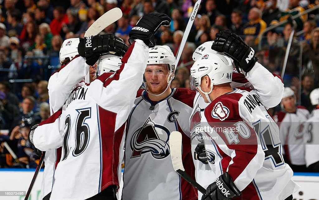 Paul Stastny #26 of the Colorado Avalanche celebrates his second period goal against the Buffalo Sabres with teammates Gabriel Landeskog #92, Ryan Wilson #44 and Alex Tanguay #40 on October 19, 2013 at the First Niagara Center in Buffalo, New York.