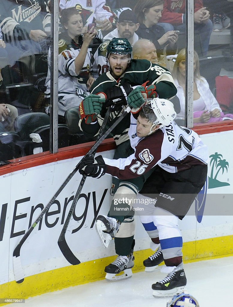 <a gi-track='captionPersonalityLinkClicked' href=/galleries/search?phrase=Paul+Stastny&family=editorial&specificpeople=2494330 ng-click='$event.stopPropagation()'>Paul Stastny</a> #26 of the Colorado Avalanche checks <a gi-track='captionPersonalityLinkClicked' href=/galleries/search?phrase=Nate+Prosser&family=editorial&specificpeople=6851127 ng-click='$event.stopPropagation()'>Nate Prosser</a> #39 of the Minnesota Wild into the boards during the second period in Game Four of the First Round of the 2014 NHL Stanley Cup Playoffs on April 24, 2014 at Xcel Energy Center in St Paul, Minnesota. The Wild defeated the Avalanche 2-1.