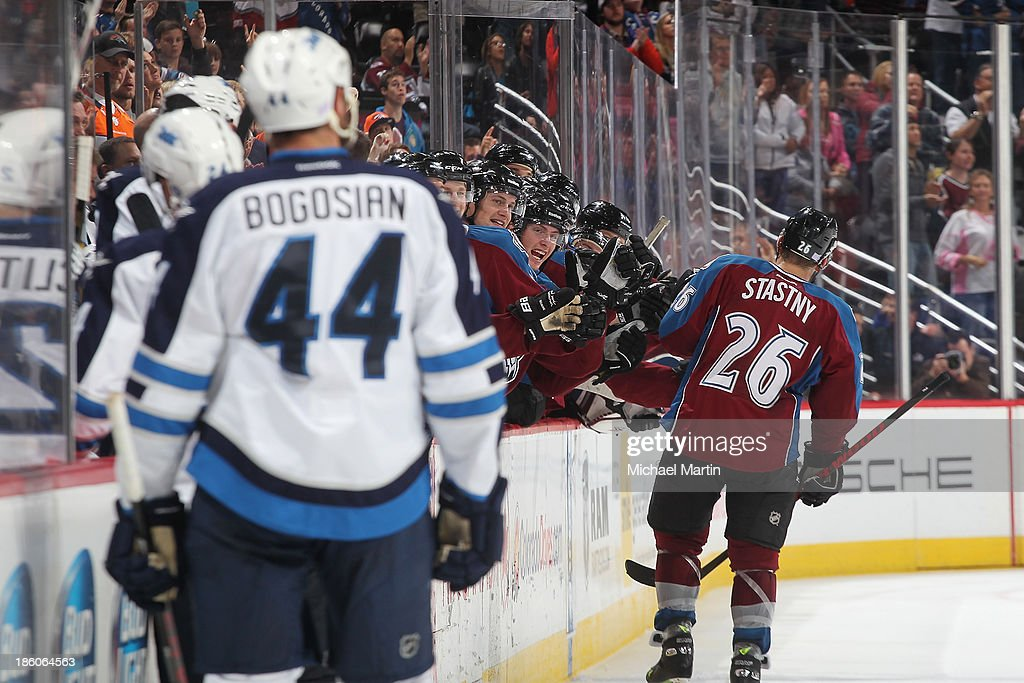 <a gi-track='captionPersonalityLinkClicked' href=/galleries/search?phrase=Paul+Stastny&family=editorial&specificpeople=2494330 ng-click='$event.stopPropagation()'>Paul Stastny</a> #26 of the Colorado Avalanche is greeted by teammates after scoring a third period goal against the Winnipeg Jets at the Pepsi Center on October 27, 2013 in Denver, Colorado.