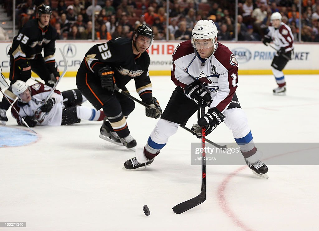 <a gi-track='captionPersonalityLinkClicked' href=/galleries/search?phrase=Paul+Stastny&family=editorial&specificpeople=2494330 ng-click='$event.stopPropagation()'>Paul Stastny</a> #26 of the Colorado Avalanche is pursued by <a gi-track='captionPersonalityLinkClicked' href=/galleries/search?phrase=Francois+Beauchemin&family=editorial&specificpeople=604125 ng-click='$event.stopPropagation()'>Francois Beauchemin</a> #23 of the Anaheim Ducks for the puck in the second period at Honda Center on April 10, 2013 in Anaheim, California. The Avalanche defeated the Ducks 4-1.