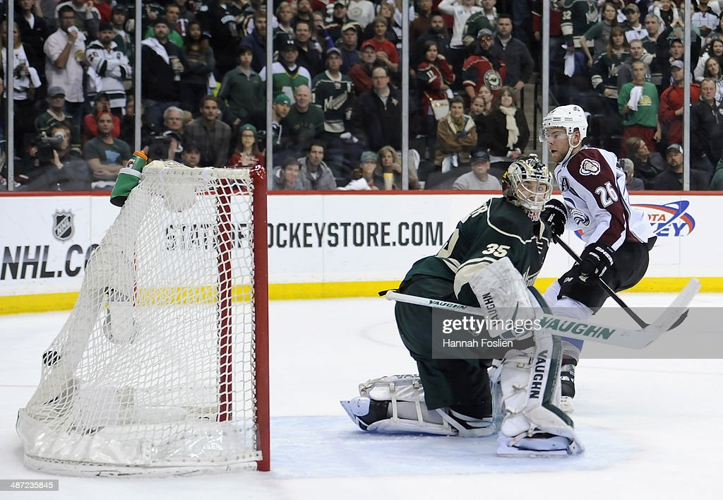Paul Stastny of the Colorado Avalanche scores a goal shorthanded as Darcy Kuemper of the Minnesota Wild watches the puck hit the back of the net...