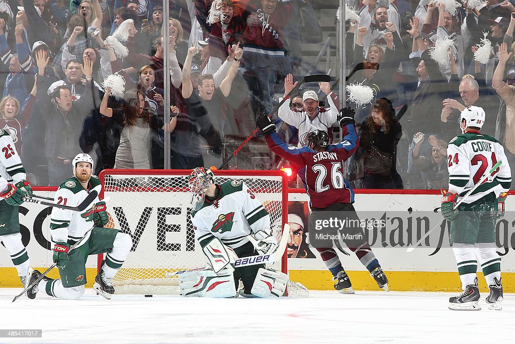 <a gi-track='captionPersonalityLinkClicked' href=/galleries/search?phrase=Paul+Stastny&family=editorial&specificpeople=2494330 ng-click='$event.stopPropagation()'>Paul Stastny</a> #26 of the Colorado Avalanche scores the game winning goal in overtime as members of the Minnesota Wild react in Game One of the First Round of the 2014 Stanley Cup Playoffs at the Pepsi Center on April 17, 2014 in Denver, Colorado. The Avalanche defeated the Wild 5-4.