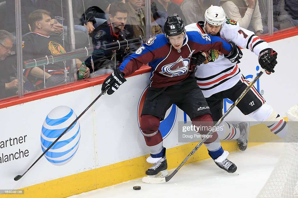 <a gi-track='captionPersonalityLinkClicked' href=/galleries/search?phrase=Paul+Stastny&family=editorial&specificpeople=2494330 ng-click='$event.stopPropagation()'>Paul Stastny</a> #26 of the Colorado Avalanche tries to control the puck against <a gi-track='captionPersonalityLinkClicked' href=/galleries/search?phrase=Brent+Seabrook&family=editorial&specificpeople=638862 ng-click='$event.stopPropagation()'>Brent Seabrook</a> #7 of the Chicago Blackhawks at the Pepsi Center on March 18, 2013 in Denver, Colorado. The Blackhawks defeated the Avalanche 5-2.
