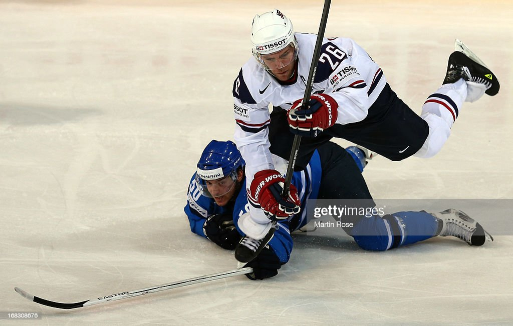 <a gi-track='captionPersonalityLinkClicked' href=/galleries/search?phrase=Paul+Stastny&family=editorial&specificpeople=2494330 ng-click='$event.stopPropagation()'>Paul Stastny</a> (#26) of USA and Juhamatti Aaltonen (#50) of Finland battle for the puck during the IIHF World Championship group H match between USA and Finland at Hartwall Areena on May 8, 2013 in Helsinki, Finland.