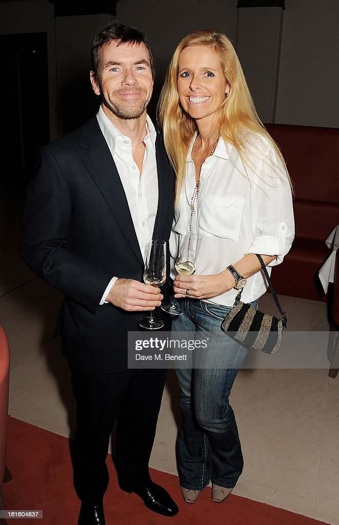 Paul Stewart (L) and wife Victoria attend a private dinner hosted by Lucy Yeomans celebrating Jason Brooks at Cafe Royal on February 12, 2013 in London, England.