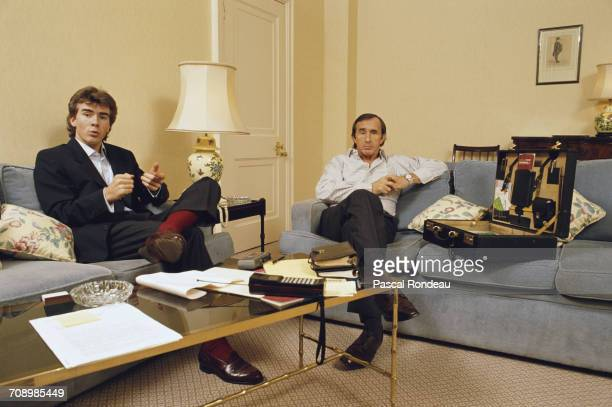 Paul Stewart of Great Britain and his father former three time Formula One Grand Prix world champion Jackie Stewart discuss their future motor racing...