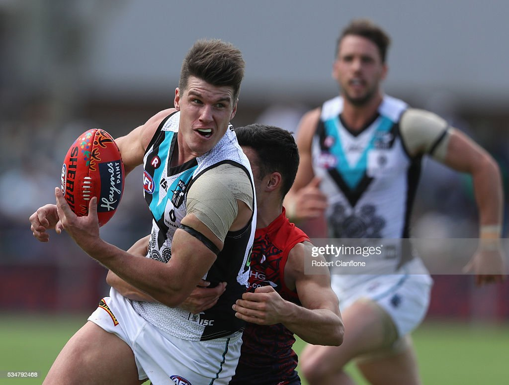 Paul Stuart of Port Adelaide handballs during the round 10 AFL match between the Melbourne Demons and the Port Adelaide Power at Traeger Park on May 28, 2016 in Alice Springs, Australia.