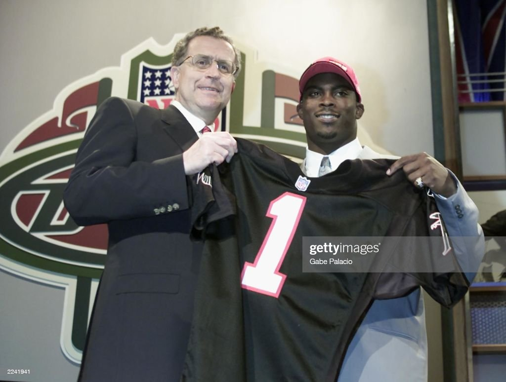 Paul Tagliebue poses with Michael Vick who was the top pick by the Atlanta Falcons and the pick overall in the NFL Draft 2001 at Madison Square...
