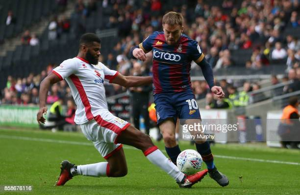 Paul Taylor of Bradford City is challenged by Ethan EbanksLandell of Milton Keynes Dons dur2ing the Sky Bet League One match between Milton Keynes...