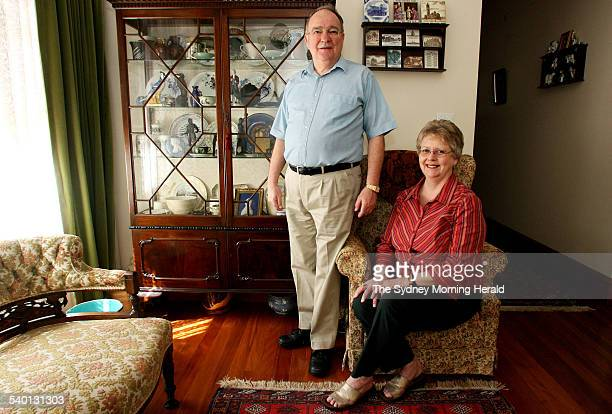 Paul Thomas and his wife Zena with a cabinet filled with Wedgwood wares at their home in Epping 28 September 2006 SMH Picture by DOMINO POSTIGLIONE