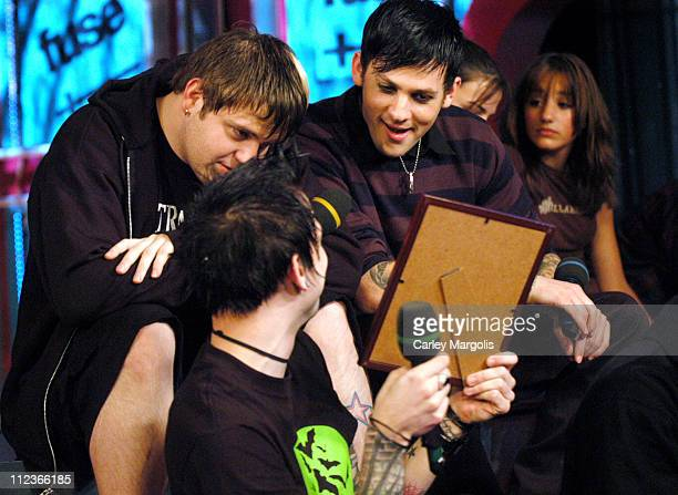 Paul Thomas Billy Martin and Joel Madden of Good Charlotte look at plaques they received from fans *Exclusive*