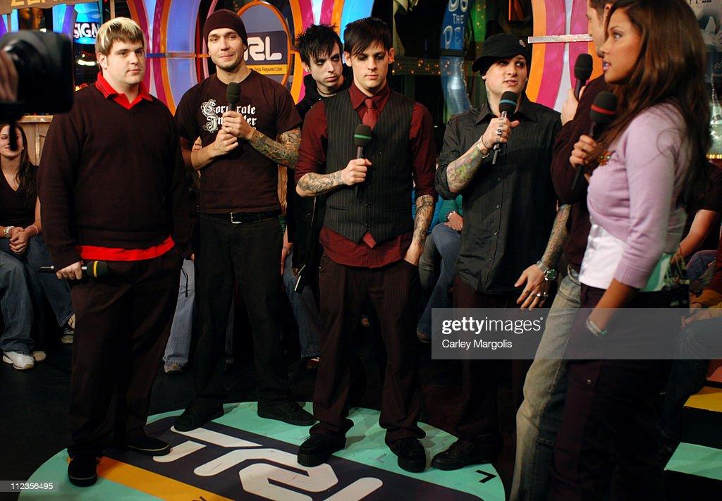 Paul Thomas Chris Wilson Billy Martin Joel Madden and Benji Madden of Good Charlotte with TRL VJs Damien Fahey and Vanessa Minnillo