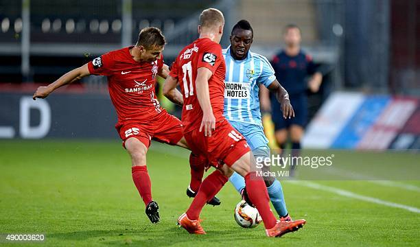 Paul Thomik of Wuerzburg Richard Weil of Wuerzburg and Reagy Ofosu of Chemnitz compete for the ball during the Third League match between Wuerzburger...