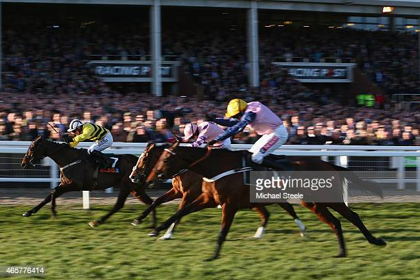 Paul Townend riding Glens Melody on his way to victory from Noel fehily riding Bitofapuzzle and Barry Geraghty riding Polly Peachum in the Olbg...