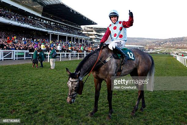 Paul Townend riding Irish Cavalier wins The Chaps Restaurant barbados Novices' Handicap Steeple Chase at Cheltenham racecourse on March 10 2015 in...