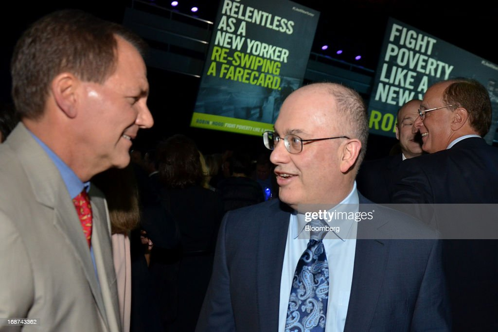 Paul Tudor Jones, co-founder of Robin Hood Foundation and founder of Tudor Investment Corp., left, speaks with Steve Cohen, founder of SAC Capital Advisors, at the Robin Hood Foundation Gala in New York, U.S., on Monday, May 13, 2013. The annual event raises money for the Robin Hood Foundation, which funds and partners with programs to alleviate poverty in the lives of New Yorkers. Photographer: Amanda Gordon/Bloomberg via Getty Images