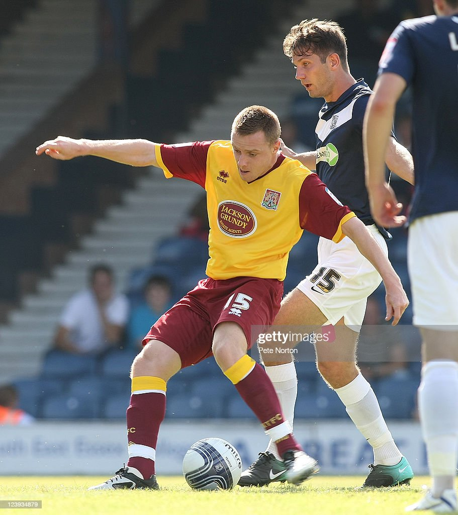 Paul Turnbull of Northampton Town attempts to play the ball under pressure from Mark Phillips of Southend United during the npower League Two match between Southend United and Northampton Town at Roots Hall on September 3, 2011 in Southend, England.