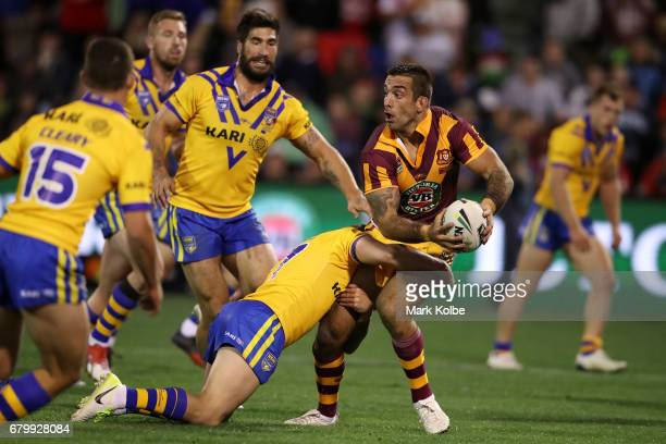 Paul Vaughan of Country looks to pass as he is tackled during the 2017 City versus Country Origin match at Glen Willow Sports Ground on May 7 2017 in...