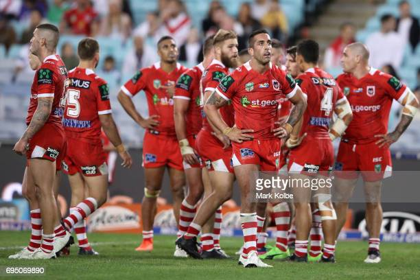 Paul Vaughan of the Dragons and his team mates look dejected after a Bulldogs try during the round 14 NRL match between the Canterbury Bulldogs and...