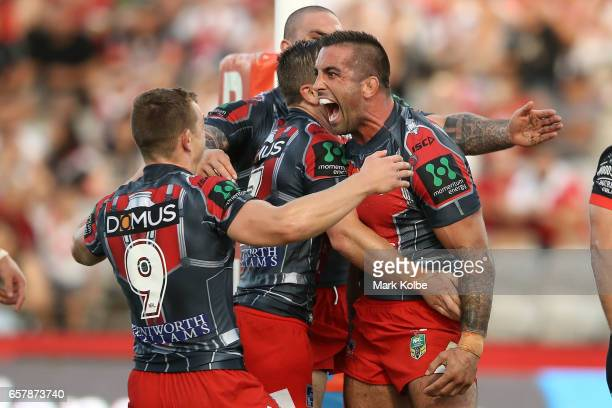 Paul Vaughan of the Dragons celebrates with his team mates after scoring a try during the round four NRL match between the St George Illawarra...