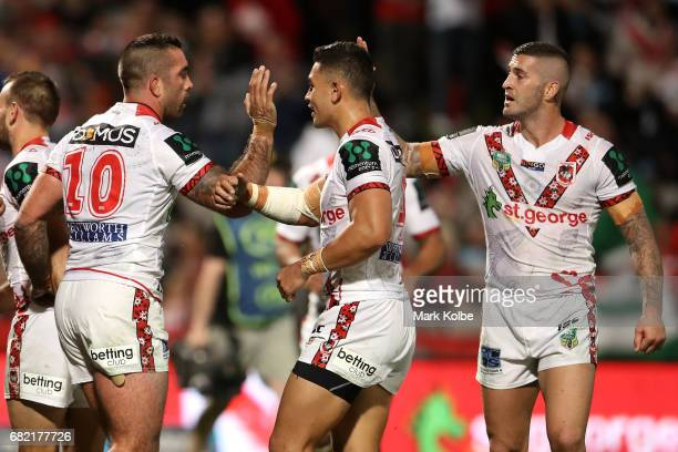 Paul Vaughan of the Dragons celebrates with his team mates Tim Lafai and Joel Thompson of the Dragons after scoring a try during the round 10 NRL...