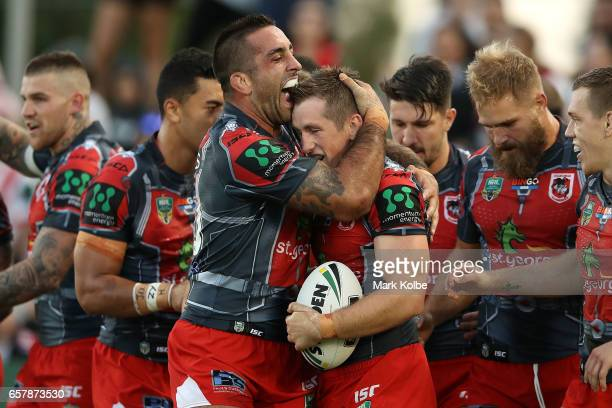 Paul Vaughan of the Dragons congratulates Josh McCrone of the Dragons as he celebrates scoring a try during the round four NRL match between the St...