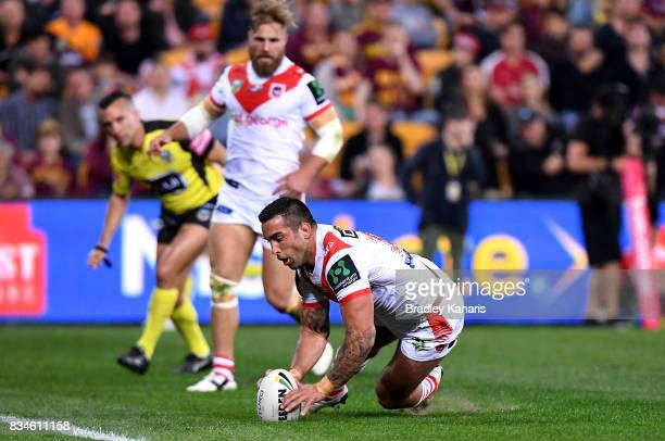 Paul Vaughan of the Dragons dives over to score a try during the round 24 NRL match between the Brisbane Broncos and the St George Illawarra Dragons...
