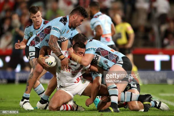 Paul Vaughan of the Dragons is tackled by Andrew Fifita and Paul Gallen of the Sharks during the round 10 NRL match between the St George Illawarra...