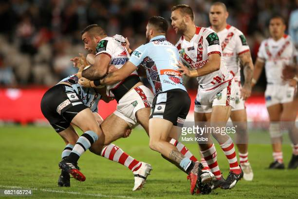 Paul Vaughan of the Dragons is tackled during the round 10 NRL match between the St George Illawarra Dragons and the Cronulla Sharks at UOW Jubilee...