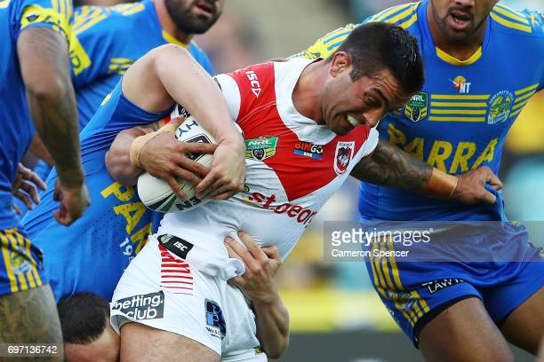 Paul Vaughan of the Dragons is tackled during the round 15 NRL match between the Parramatta Eels and the St George Illawarra Dragons at ANZ Stadium...