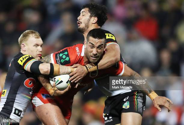 Paul Vaughan of the Dragons is tackled during the round 25 NRL match between the Penrith Panthers and the St George Illawarra Dragons at Pepper...