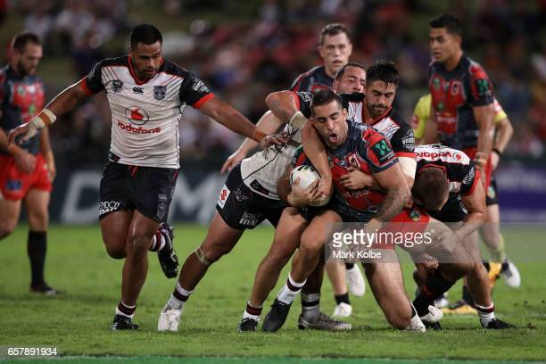 Paul Vaughan of the Dragons is tackled during the round four NRL match between the St George Illawarra Dragons and the New Zealand Warriors at UOW...