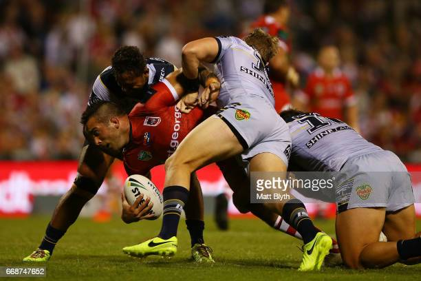Paul Vaughan of the Dragons is tackled during the round seven NRL match between the St George Illawarra Dragons and the North Queensland Cowboys at...