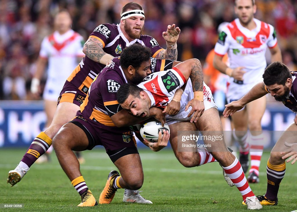 Paul Vaughan of the Dragons takes on the defence during the round 24 NRL match between the Brisbane Broncos and the St George Illawarra Dragons at Suncorp Stadium on August 18, 2017 in Brisbane, Australia.