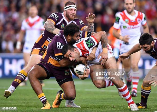 Paul Vaughan of the Dragons takes on the defence during the round 24 NRL match between the Brisbane Broncos and the St George Illawarra Dragons at...