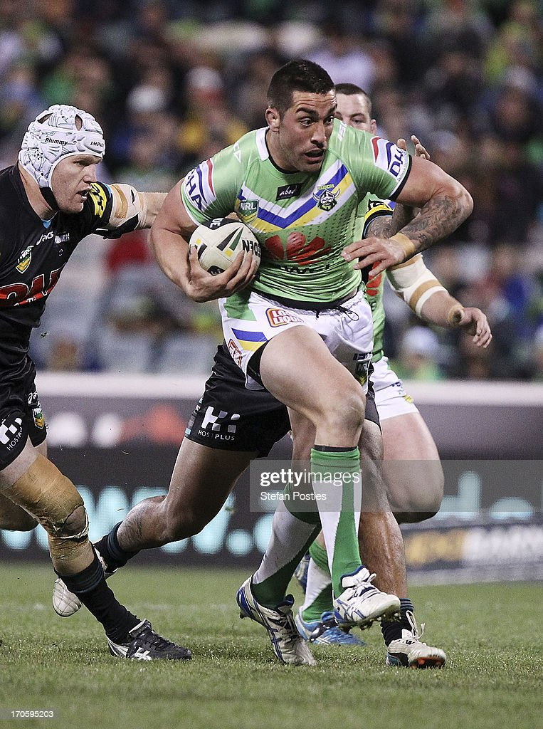 Paul Vaughan of the Raiders is tackled during the round 14 NRL match between the Canberra Raiders and the Penrtih Panthers at Canberra Stadium on June 15, 2013 in Canberra, Australia.