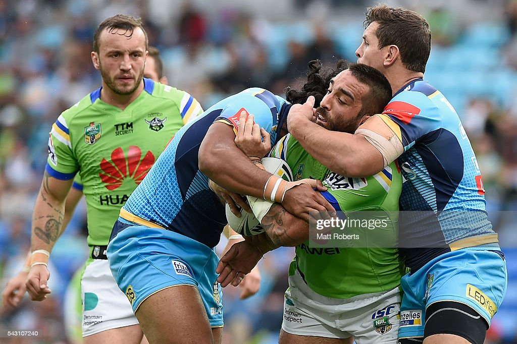 Paul Vaughan of the Raiders is tackled during the round 16 NRL match between the Gold Coast Titans and the Canberra Raiders at Cbus Super Stadium on June 26, 2016 in Gold Coast, Australia.