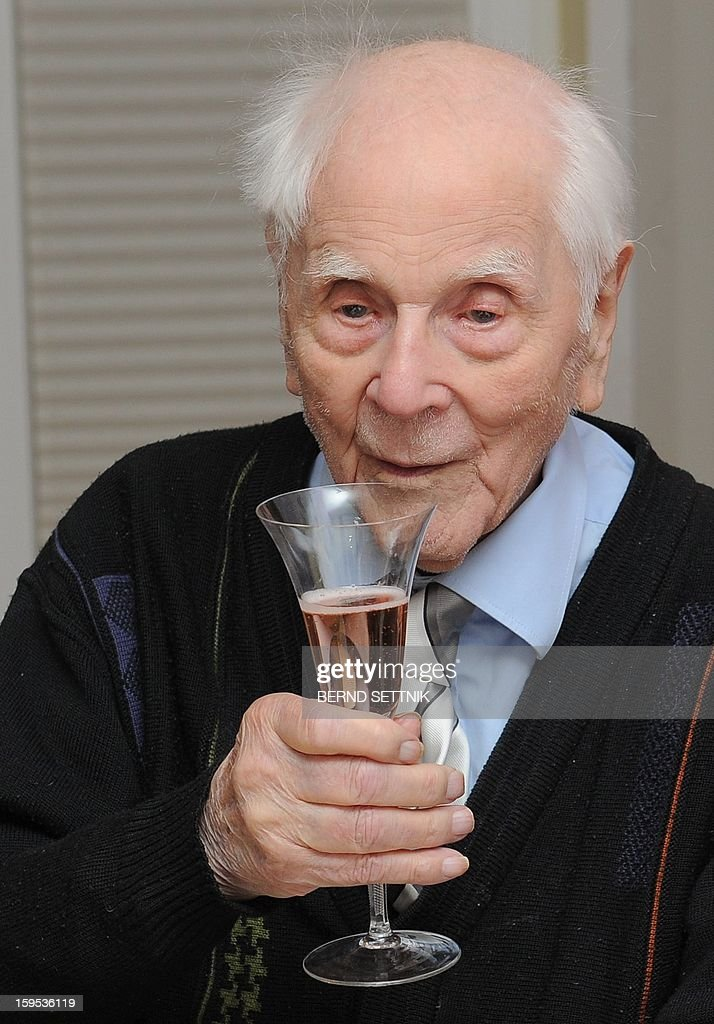 Paul Veit, 110, the oldest German, holds a glass during his birthday on January 15, 2013 at his room in Neuruppin, eastern Germany. AFP PHOTO / BERND SETTNIK /Germany Out