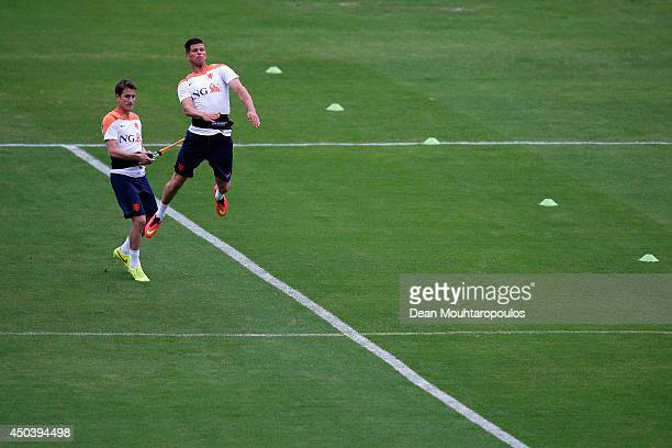 Paul Verhaegh holds back the leaping KlaasJan Huntelaar during the Netherlands training session at the 2014 FIFA World Cup Brazil held at the Estadio...