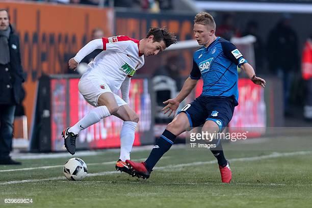 Paul Verhaegh of Augsburg and Philipp Ochs of 1899 Hoffenheim battle for the ball during the Bundesliga match between FC Augsburg and TSG 1899...
