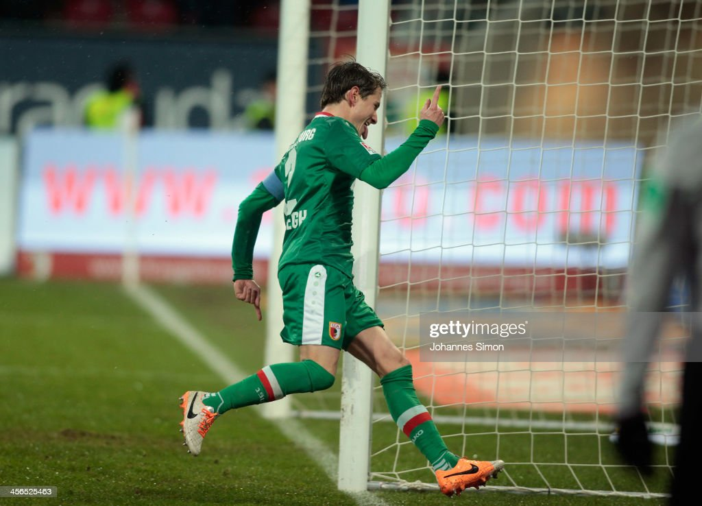 Paul Verhaegh of Augsburg celebrates after scoring his team's first goal during the Bundesliga match between FC Augsburg and Eintracht Braunschweig...