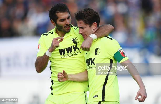 Paul Verhaegh of Augsburg celebrates his team's first goal with team mate Halil Altintop during the Bundesliga match between SV Darmstadt 98 and FC...