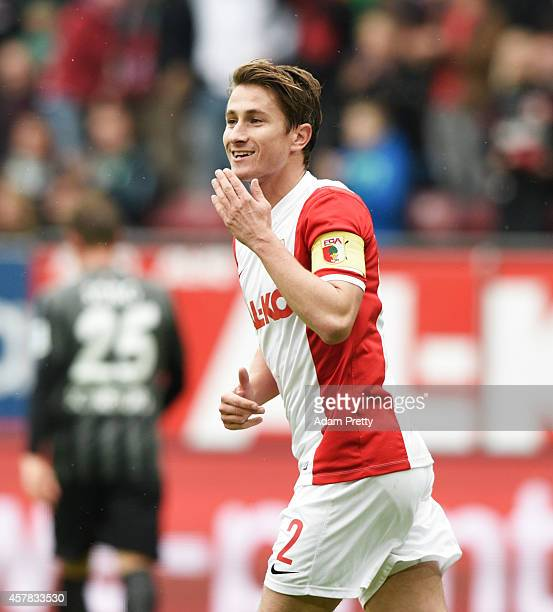 Paul Verhaegh of Augsburg celebrates scoring a penalty goal during the FC Augsburg v SC Freiburg Bundesliga match at SGL Arena on October 25 2014 in...