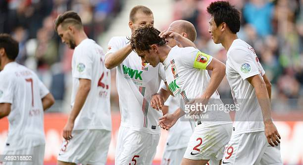 Paul Verhaegh of Augsburg celebrates with teammates after scoring his team's second goal during the Bundesliga match between FC Augsburg and Hannover...