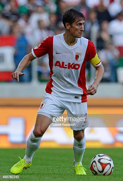Paul Verhaegh of Augsburg controls the ball during the Bundesliga match between FC Augsburg and SV Werder Bremen at SGL Arena on September 20 2014 in...